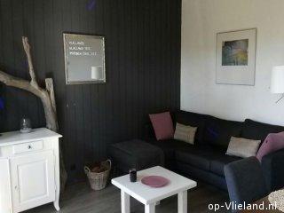 Getij, vakantiehuis voor 2 personen in het bosgedeelte van het dorp
